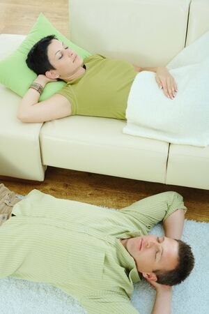 Couple sleeping at home on sofa and on floor. Stock Photo - 5183065