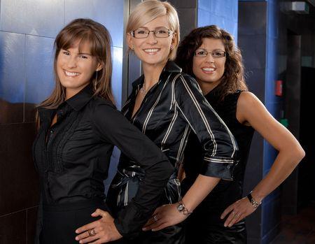 Closeup portrait of happy businesswomen posing in corporate office lobby. photo