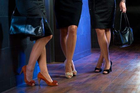 Female legs in stocking and elegant high heel shoes. photo
