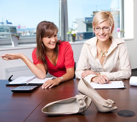 Young businesswomen discussing marketing of a new shoe product. photo