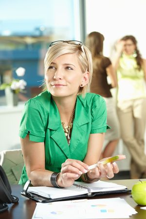 Portrait of young businesswoman sitting at office desk, thinking. Stock Photo - 5183059