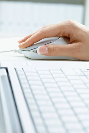 Closeup picture of computer keyboard and female hand using mouse. Stock Photo - 5732391