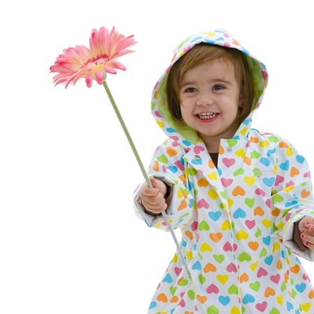 raincoat: Happy small girl wearing raincoat and boots, holding pink flower, laughing. Isolated on white background.