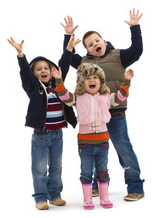 Group of 3 happy children posing together, lauging and waving. Isolated on white background. photo