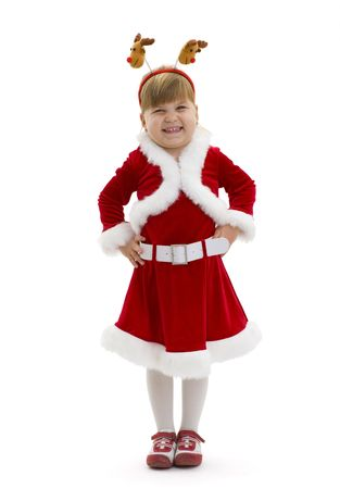 Happy little girl dressed in Santa Claus clothes, laughing. Isolated on white background. photo