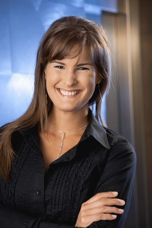 Closeup portrait of happy young businesswoman, smiling. photo