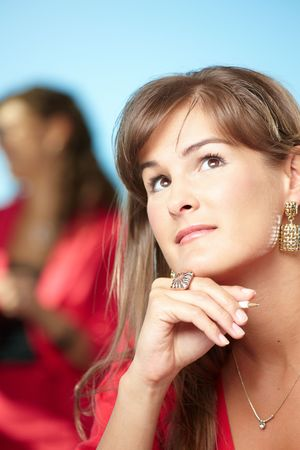 Closeup portrait of young businesswoman leaning on hand, daydreaming. photo