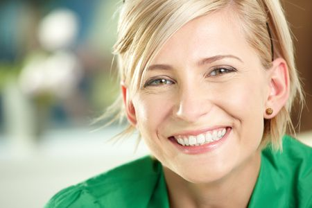 Closeup portrait of happy young businesswoman wearing green shirt, smiling. photo