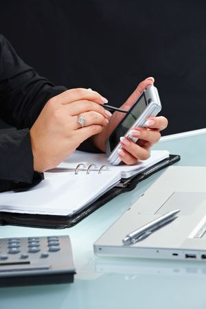 Female hand using touch screen handheld computer. photo