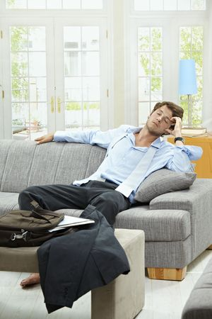 Tired businessman resting on couch at home after long day of work. Stock Photo - 5754784