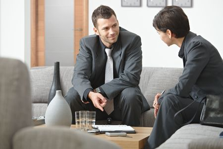 Young business people having meeting at office sitting on sofa working in team. Stock Photo - 5766967