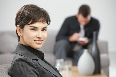 Portrait of young attractive businesswoman sitting at office lobby, smiling. Stock Photo - 5766983