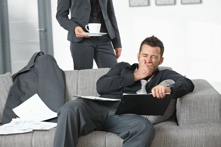 People at office. Businesswoman serving coffee to tired businessman. Stock Photo - 5766765