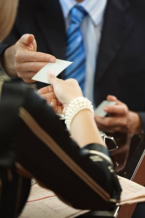 Closeup photo of hands exchanging business card. Stock Photo - 5783552