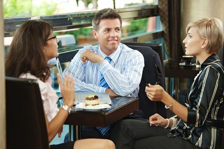 Young businessman and businesswomenhaving a meeting in cafe. photo