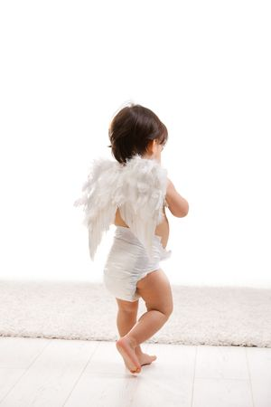 angel alone: One year old baby girl wearing white angel wings and diaper. Back view, isolated on white background. Stock Photo