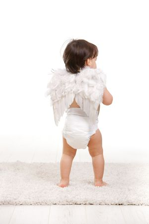 angel alone: One year old baby girl in angel wing costume and diaper. Back view, isolated on white background.