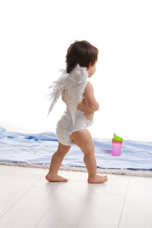 One year old baby girl wearing white angel wings. Back view. Isolated on white background. photo