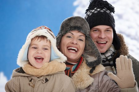 Portrait of happy family together outdoor in snow on a cold winter day, laughing, smiling. Stock Photo - 5806417