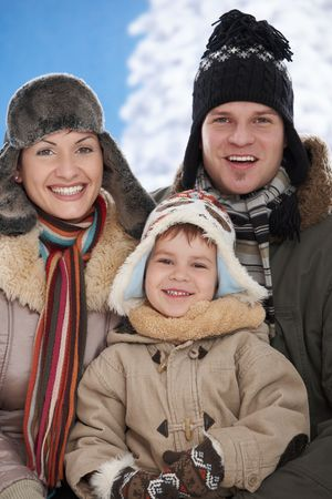 Portrait of happy family together outdoor in snow on a cold winter day, laughing, smiling. photo