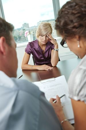 applicant: Woman applicant after failed job interview. Over the shoulder view. Stock Photo