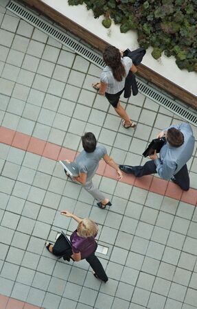 Team of busy business people walking, overhead view.