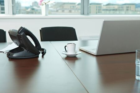 Phone, laptop compuer and coffee cup on office desk. photo