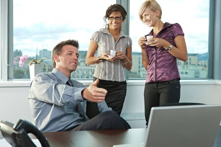 Happy young business people working in team at office meeting room, smiling. photo
