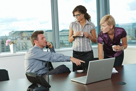 Young business people working in team at office meeting room. photo