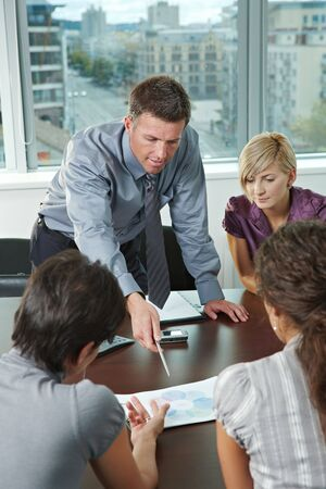 Group of young business people talking on business meeting at office. Stock Photo - 5806503