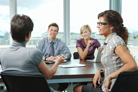 Group of young business people talking on business meeting at office. photo