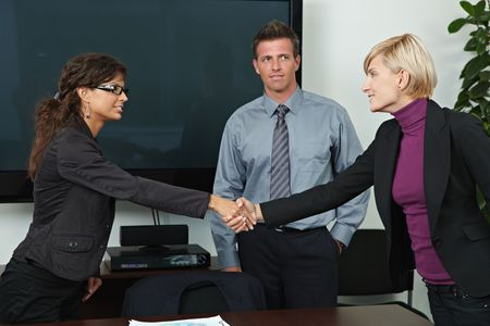 offiice: Business people shaking hands over table in offiice meeting room. Stock Photo
