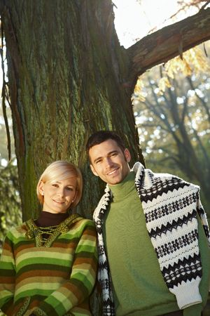 Young love couple outdoor in park at autumn, smiling. photo