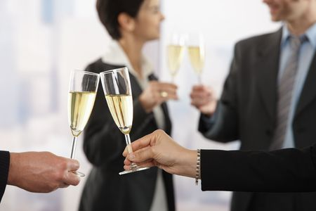 toast: Business people raising toast with champagne at office, focus placed on flutes. Stock Photo