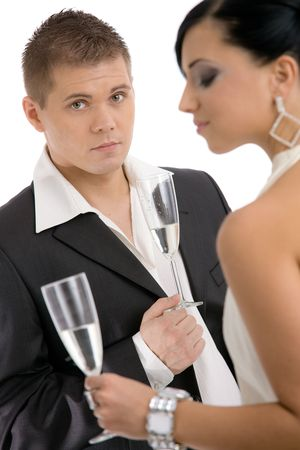 open shirt: Trendy young coupledrinking champagne. Isolated on white background, selective focus on man.