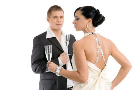 Trendy young coupledrinking champagne. Isolated on white background, selective focus on woman. photo