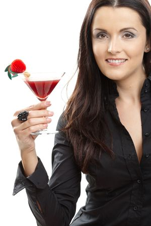 Attractive young woman holding glass of cocktail in hand, smiling. photo