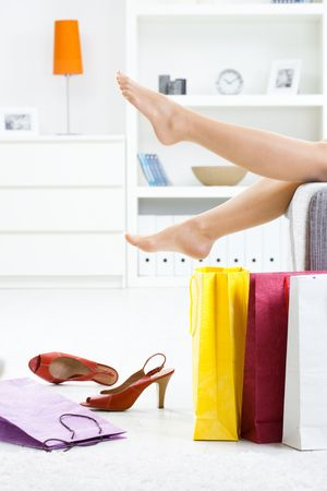 long feet: Woman legs in stockings, taking off high heel shoes. Stock Photo