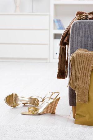 femal: Newly bought femal clothes and shoes packed out at home. Stock Photo