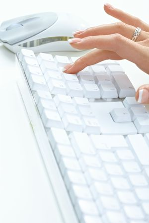Closeup picture of female hand typing on desktop computer keyboard. photo