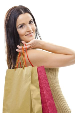 Closeup portrait of attractive young woman holding shopping bags. Isolated on whte. photo