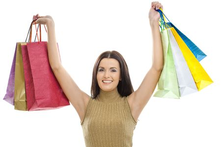 Happy young woman wearing mini skirt posing with shopping bags. Isolated on whte. photo