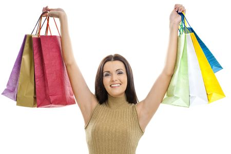 Closeup portrait of happy young woman holding shopping bags. Isolated on whte. photo