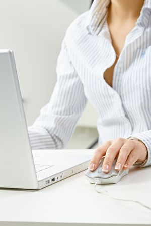Closeup of female fingers and nails on computer mouse. Stock Photo - 5932492