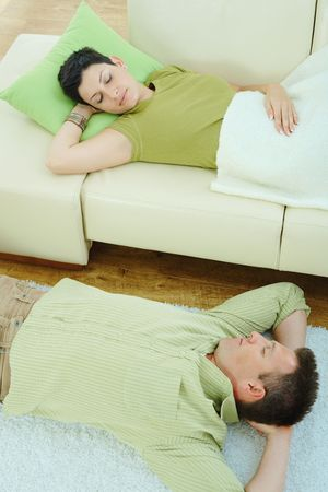 Couple sleeping at home on sofa and on floor. Stock Photo - 5933212