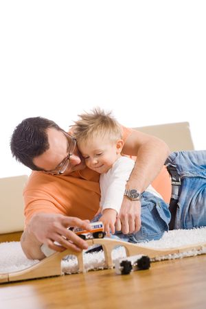 Father and kid having fun together at home. photo