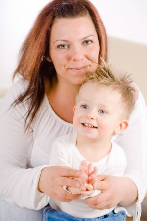 Happy mother and baby boy ( 2 years old ) clapping together at home, smiling. Stock Photo - 5943344