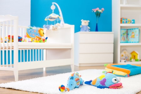 toy bear: Crib and soft baby toys at childrens room. Toys are officially property released. Stock Photo