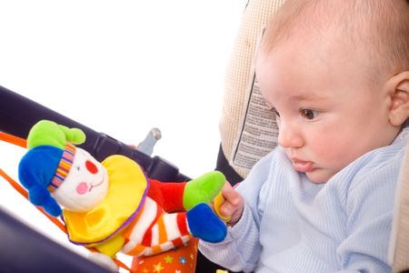 Baby playing in baby carrier. Toys are property released. photo