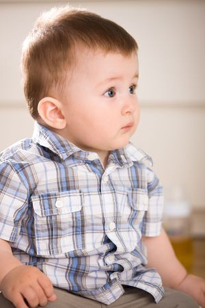 Portrait of cute baby boy ( 1 year old ) at home, looking away. Stock Photo - 5943446